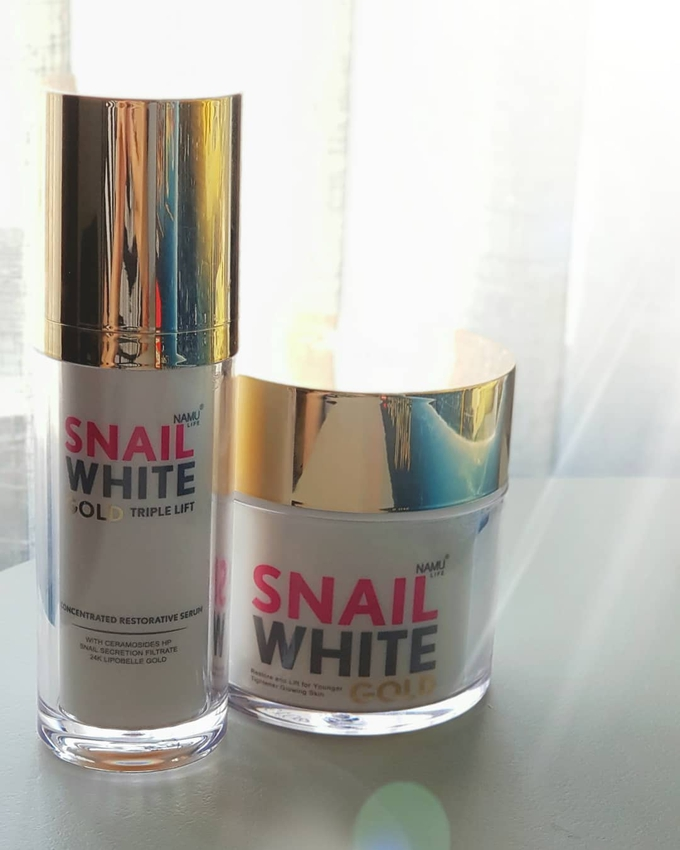 A bottle of Snail White serum and a tub of Snail White facial cream