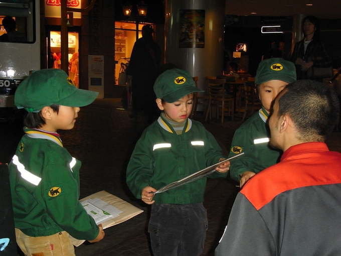 Three children dressed up as delivery men